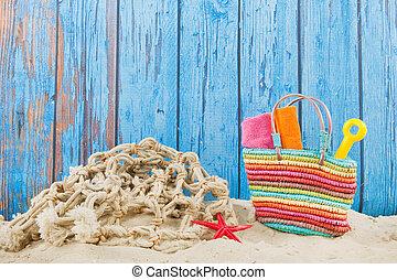 Beach bag in sand
