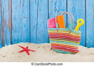 Beach bag in sand - Colorful beach bag with toys at the ...