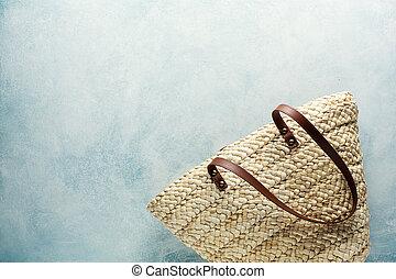 Beach bag on a blue background.