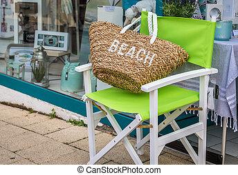 Beach bag on a green Chair