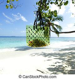 Beach bag on sea background