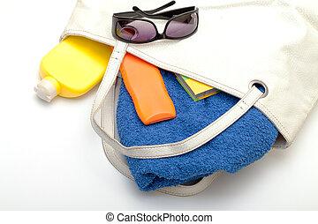 Beach Bag with Towel and Bottles Cream, closeup