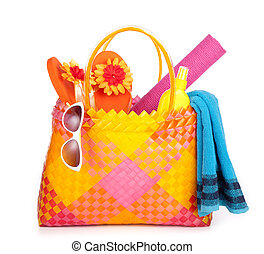 beach bag with towel sunglasses flip-flops and hat. isolated on white