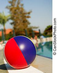 Beach ball near swimming pool