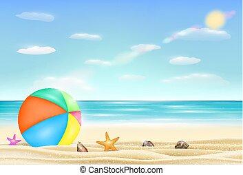 beach ball on a sea sand beach with starfish and shell