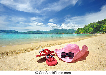 Beach - Beautiful beach landscape with hat and flip-flops in...