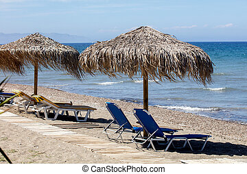 Beach bed and umbrellas