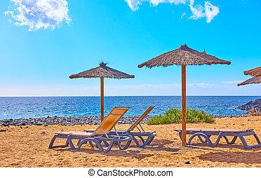 Beach by the sea on sunny summer day