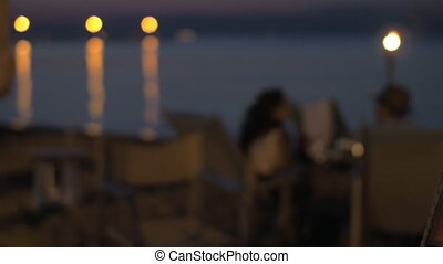 Beach cafe with couple in the evening
