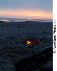Beach Campfire at Dusk with Ocean in the background