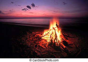 Beach Campfire on Lake Superior - Blazing campfire at sunset...