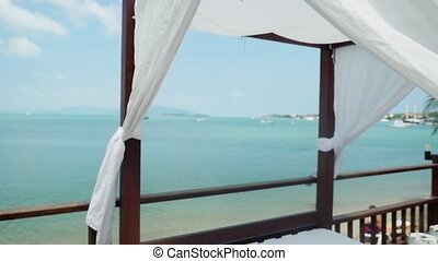 Beach canopies with sun loungers on sea view in sunny day....