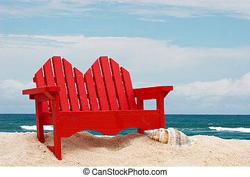 A wooden beach chair sitting on the sand with water, beach chair