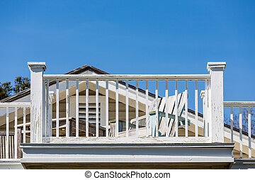 Beach Chair and Balcony Needing Paint