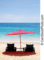 Beach chair and Red Umbrella on the beach