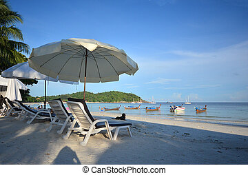Beach chair and umbrella on idyllic tropical sand beach. Lipe, Thailand