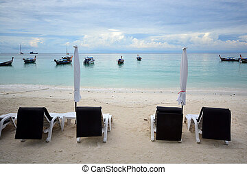 Beach chair and umbrella on idyllic tropical sand beach. Lipe, Thailand