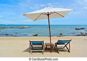 Beach chair and umbrella on idyllic tropical sand beach. Phuket, Thailand