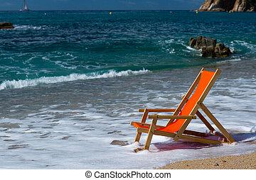 Beach chair in the sea