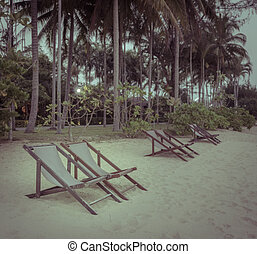 Beach chair on beach in vintage effect