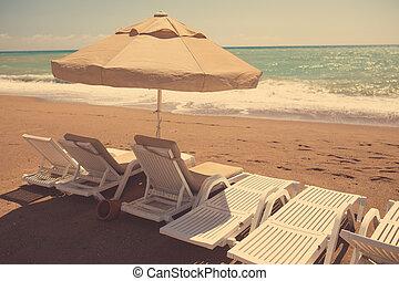 Beach chair on sand beach, retro tinted