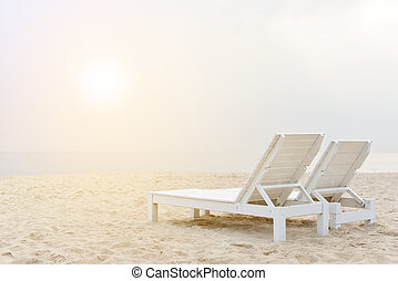 beach chair on the beach with sunset