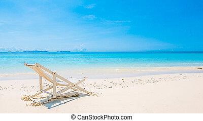 Beach chair on tropical beach sand