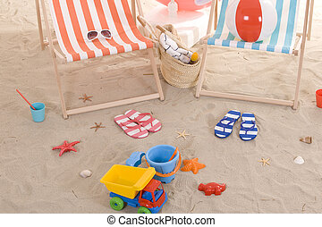 beach chair with colorful towel and toys