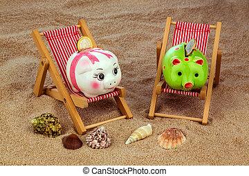 beach chair with piggy bank on the sandy beach. symbolic ...