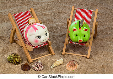 beach chair with piggy bank on the sandy beach. symbolic...