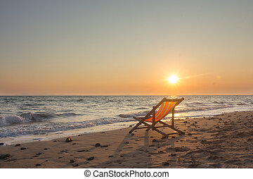 Beach chair with sunset