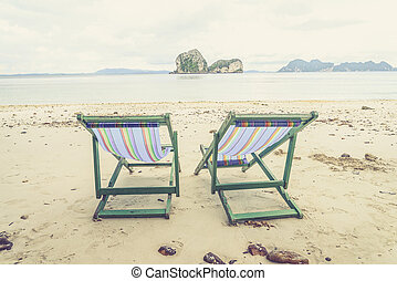 Beach chairs and beautiful beach (Vintage filter effect used)