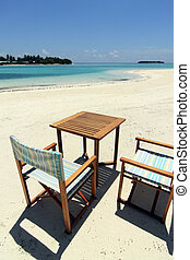 Beach chairs and table - A set of beach chairs and table on...
