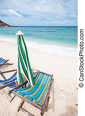 Beach chairs and with umbrella on the beach