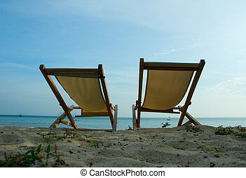 beach chairs at tropical resort
