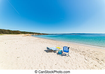 beach chairs on a empty beach