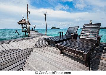Beach chairs on a wooden bridge