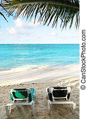 Beach chairs on ocean shore