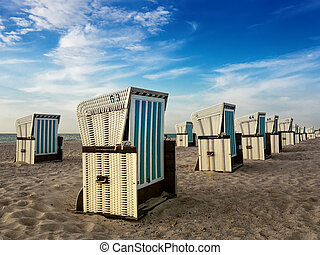 Beach chairs on shore of the Baltic Sea in Warnemuende (Germany).