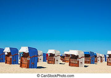 Beach chairs on the Baltic Sea coast in Warnemuende, Germany
