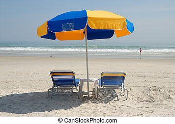 beach chairs on the beach at daytona beach florida usa