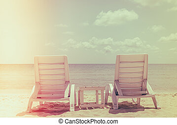 Beach chairs on tropical white sand beach ( Filtered image processed vintage effect. )