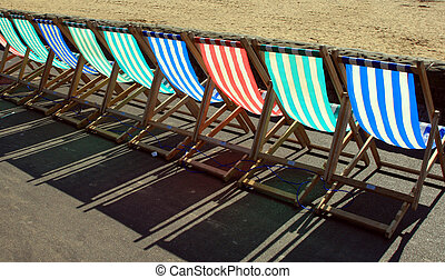 Beach chairs - row of beach chairs on the sea front
