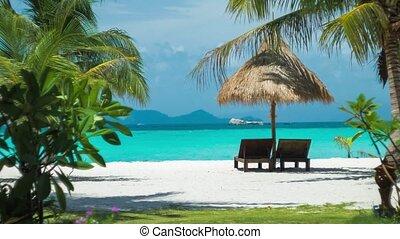 Beach chairs, umbrella and palms on the beach. Dreamy Look. Koh Lipe Island, Thailand, Asia