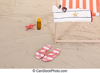 beach chairs with colorful towels and toys - beach chair...