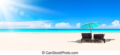 Panorama of tropical beach with white sand and turquoise water.