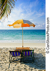 Beach chairs with umbrella at morning, samed island,thailand