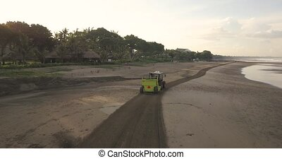Beach cleaning tractor at Kuta, Bali, Indonesia