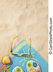 beach items on a towel with copy-space