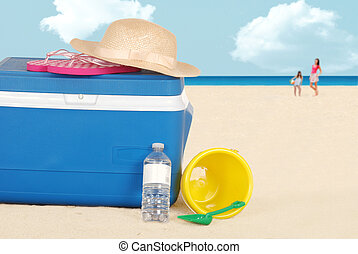 beach cooler with hat bottle water - closeup beach cooler...